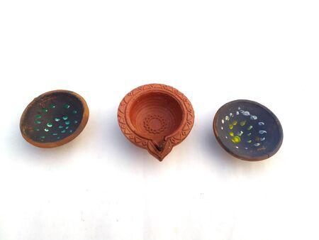 Traditional clay diya lamps lit during diwali celebration Zdjęcie Seryjne - 133360008