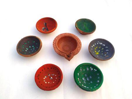 Traditional clay diya lamps lit during diwali celebration Zdjęcie Seryjne - 133360011