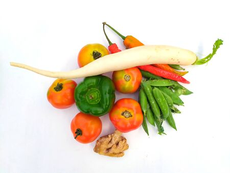 many fresh healthy vegetable put in a plastic boul isolated on white background