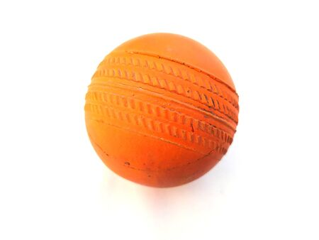 a orange color dirty rubber ball isolated on white background