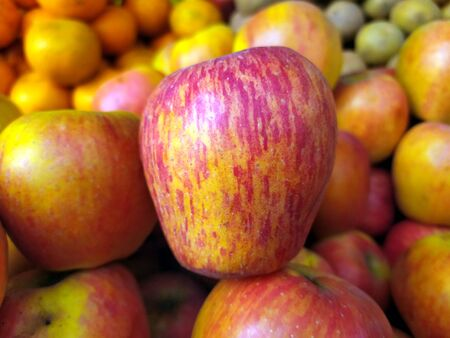 red and yellow fresh sweet apple put on street fruits shop