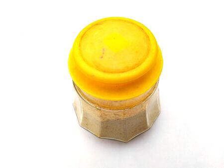 yellow color glass food jar isolated on white background Zdjęcie Seryjne