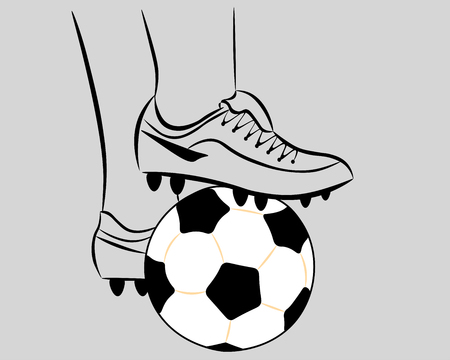 On a gray background - a white soccer ball, pressed with the feet of a football player in boots.