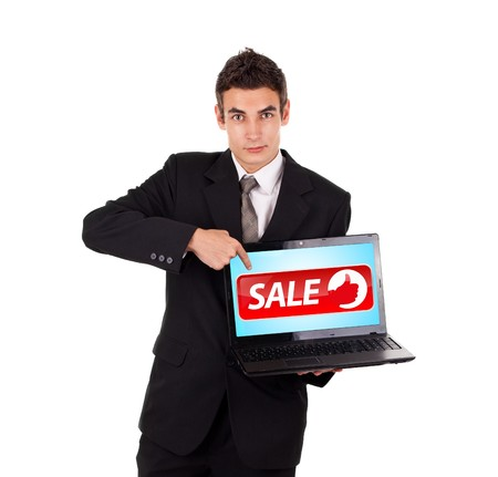 Business man pointing at a laptop with sale sign, isolated on white Stock Photo - 7756435