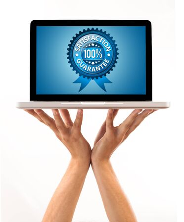 a male hand holding a laptop with Satisfaction Guarantee Label , isolated on white Stock Photo - 7857605