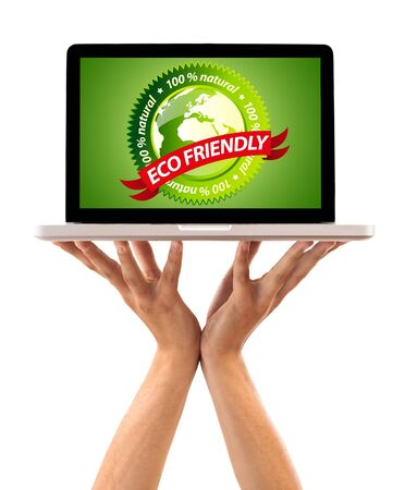 Hand holding laptop with eco friendly sign, isolated on white Stock Photo - 7857645