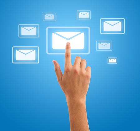 hand choosing mail symbol on blue background Stock Photo - 7857670