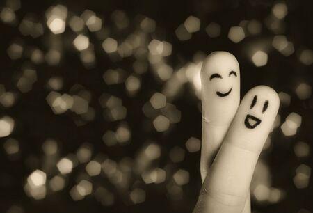 fidelidad: Dedo abrazo con el resumen de las luces de 2  Foto de archivo