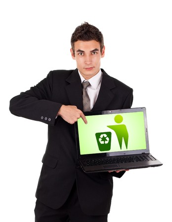 Business man pointing at a laptop with recycle icon isolated on white photo