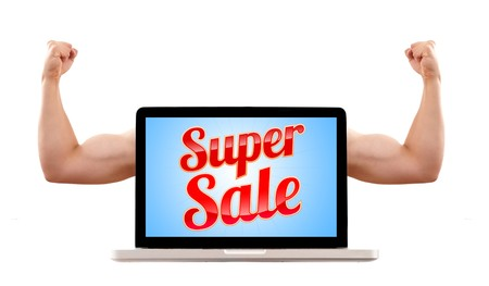 unbeatable: Isolated modern laptop with super sale sign and muscular biceps