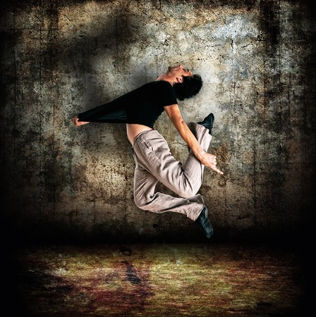 contemporary dance: stylish modern dancer posing on instrustrial backround