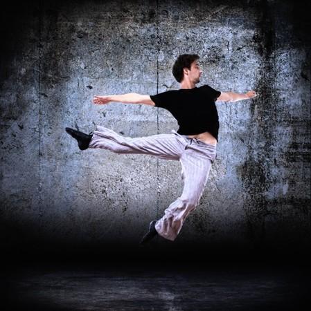 street dance: stylish modern dancer posing on instrustrial backround 2