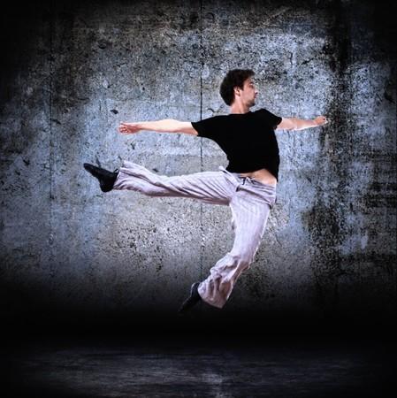 stylish modern dancer posing on instrustrial backround 2 Stock Photo - 7952692