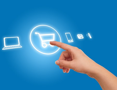 hand choosing shopping cart symbol from media icons on blue Stock Photo
