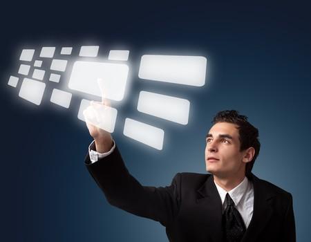Business man pressing a touchscreen button.  Stock Photo - 8037287