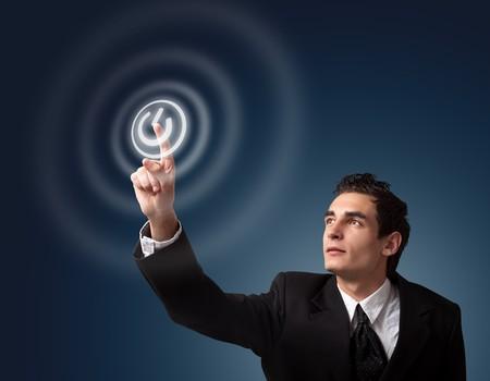 boton on off: hombre de negocios presionando ON  OFF bot�n  Foto de archivo