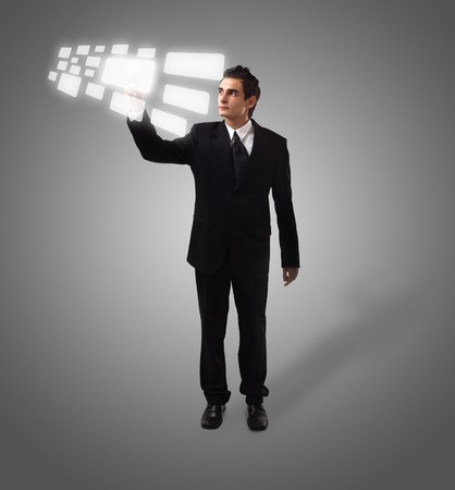 Business man pressing a touchscreen button, futuristic digital technology Stock Photo - 8037272