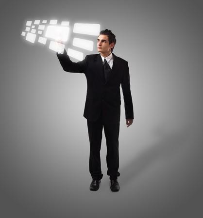 Business man pressing a touchscreen button, futuristic digital technology Stock Photo - 8037272