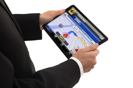 global positioning: businessman holding a touchpad pc, using the navigation program, isolated on white background