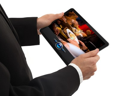 male hand holding a touchpad pc showing a movie, isolated on white Stock Photo - 8037186