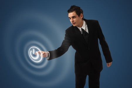 business man pressing ON / OFF button  Stock Photo - 8116010