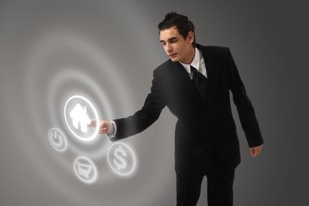 business man choosing home button photo
