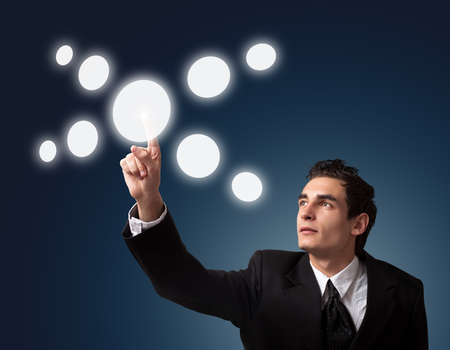 business man pressing a touchscreen button Stock Photo - 8261648