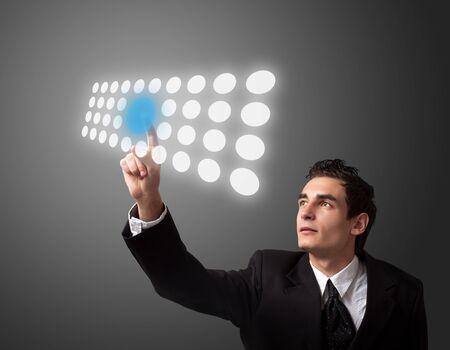 Business man pressing a touchscreen button. Stock Photo - 8261651