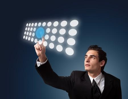 Business man pressing a touchscreen button. Stock Photo - 8261649