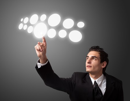 Business man pressing a touchscreen button.  Stock Photo - 8261639
