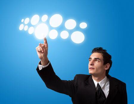 Business man pressing a touchscreen button. Stock Photo - 8261737