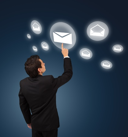 business man pressing e-mail button Stock Photo - 8261776