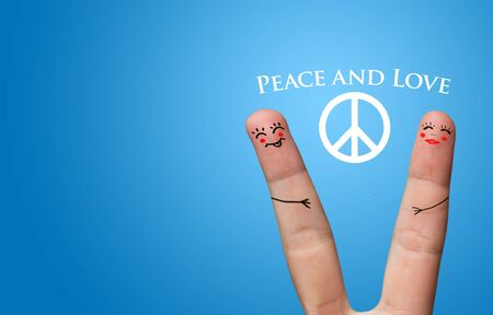 Painted finger smiley, peace and love theme Stock Photo - 8507183