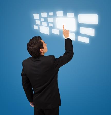 Business man pressing a touchscreen button Stock Photo - 8584845
