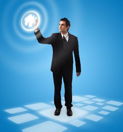 business man pressing HOME button, futuristic digital technology photo
