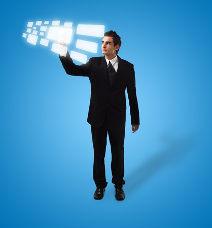 Business man pressing a touchscreen button, futuristic digital technology Stock Photo - 8584825