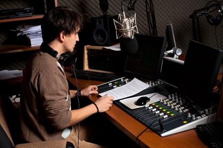 radio dj: radio dj man indoor at radio studio