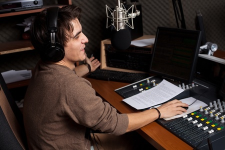 disc jockey: Radio DJ. Young man with microphone and headphone.