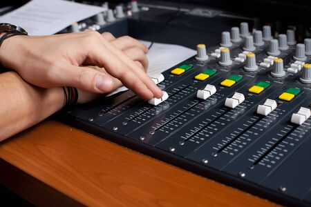 diminishing perspective: mixing desk and human hand diminishing perspective  Stock Photo