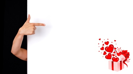 woman hand pointing to white wall photo
