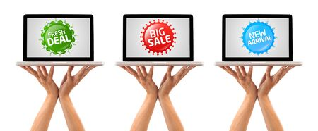 Hand holding laptop with Colorful sale label collection, isolated on white photo