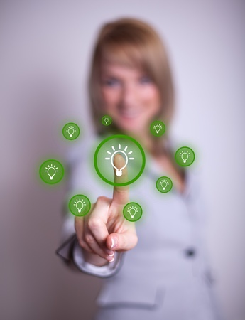 option key: woman hand pressing light bulp icon