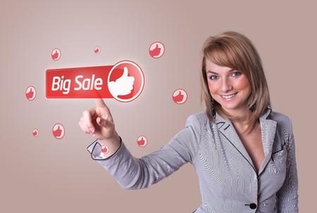 woman hand pressing BIG SALE button photo