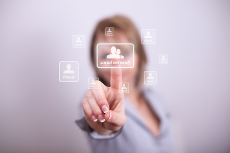 Woman pressing social media button with one hand Stock Photo - 8725501