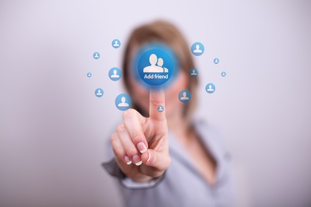Woman pressing social button with one hand photo
