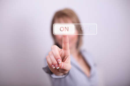 Woman pressing on off button with one hand photo