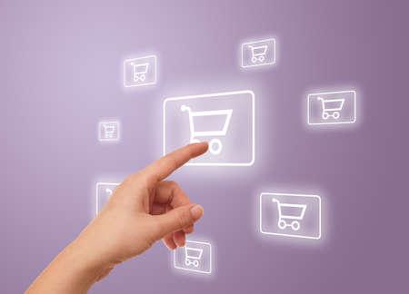 woman hand pressing shopping cart icon photo