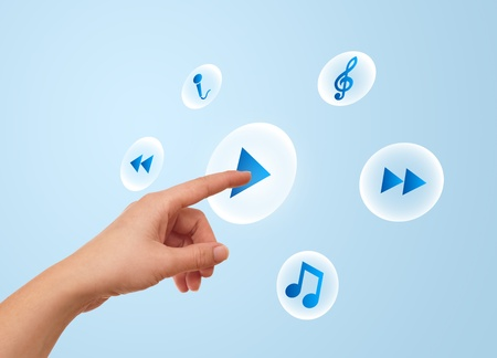 woman hand pressing media player button Stock Photo - 8724516
