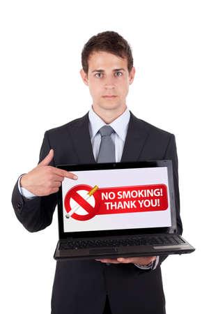 anti smoking: Businessman holding a NO SMOKING sign on white