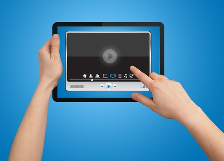 A male hand holding a touchpad media player state of the art photo